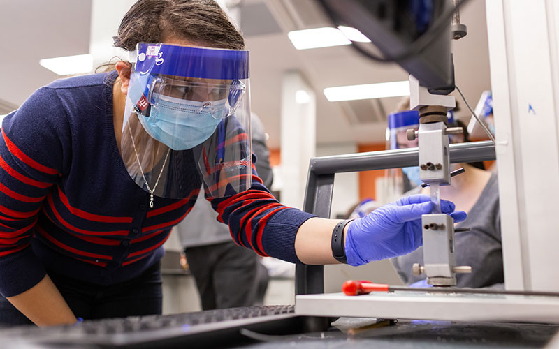 Student using lab equipment during class in a biomedical engineering lab on IUPUI campus.