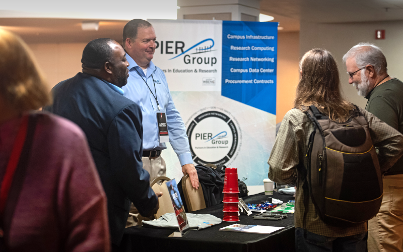 Conference attendees at a vendor table