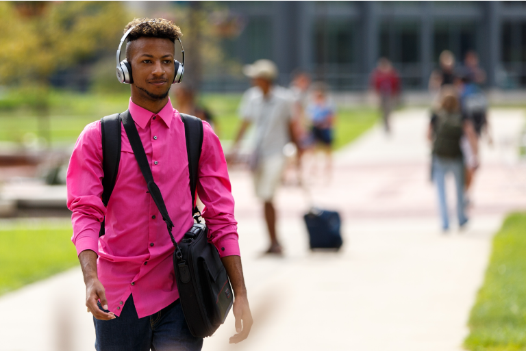 A student walking on campus